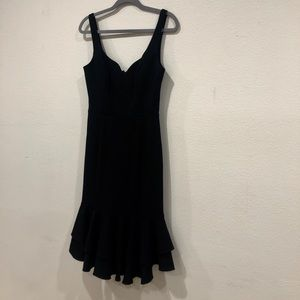 Black dress with ruffles.